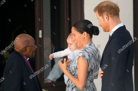 Prince Harry and Meghan Duchess of Sussex, holding their son Archie Harrison Mountbatten-Windsor, meet Archbishop Desmond Tutu at the Desmond & Leah Tutu Legacy Foundation in Cape Town, South Africa