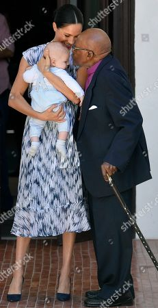 Meghan Duchess of Sussex, holding her son Archie Harrison Mountbatten-Windsor, meets Archbishop Desmond Tutu at the Desmond & Leah Tutu Legacy Foundation in Cape Town, South Africa