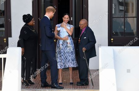Stock Photo of Prince Harry and Meghan Duchess of Sussex, holding their son Archie Harrison Mountbatten-Windsor, meet Archbishop Desmond Tutu and his daughter Thandeka at the Desmond & Leah Tutu Legacy Foundation in Cape Town, South Africa