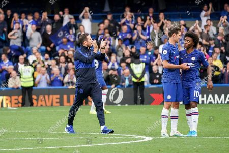 Chelsea Manager Frank Lampard thanks the fans as Andreas Christensen and Willian of Chelsea celebrate their win