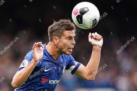 Cesar Azpilicueta of Chelsea heads the ball