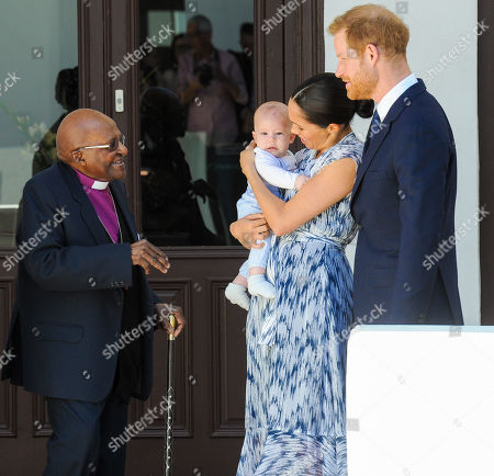 Prince Harry and Meghan Duchess of Sussex, holding son Archie Harrison Mountbatten-Windsor, meet Archbishop Desmond Tutu during a visit to the Desmond & Leah Tutu Legacy Foundation in Cape Town, South Africa.