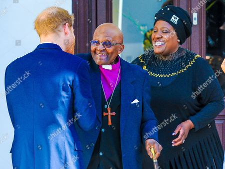 Prince Harry meets Archbishop Desmond Tutu and his daughter Thandeka at the Desmond & Leah Tutu Legacy Foundation in Cape Town, South Africa