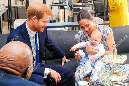 Prince Harry and Meghan Duchess of Sussex, holding their son Archie Harrison Mountbatten-Windsor, meet Archbishop Desmond Tutu and his daughter Thandeka at the Desmond & Leah Tutu Legacy Foundation in Cape Town, South Africa