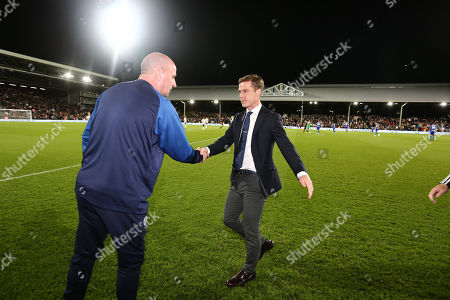 Scott Parker manager of Fulham  shakes hands with Paul Cook manager of Wigan Athletic