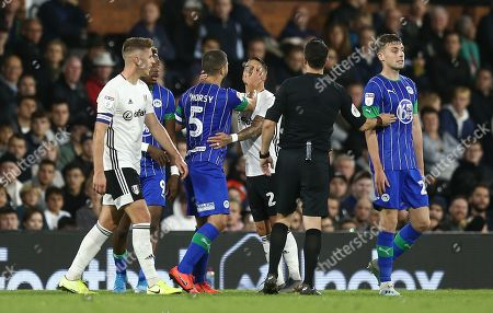 Sam Morsy of Wigan Athletic appears to be pushing  Anthony Knockaert of Fulham