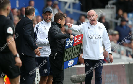 Mark Warburton - Manager of QPR (R) is unhappy with Matheus Pereira of West Bromwich Albion (out of picture) after an altercation with Ryan Manning of QPR as he left the field