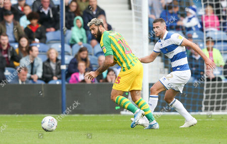 Charlie Austin of West Bromwich Albion takes on Dominic Ball of QPR