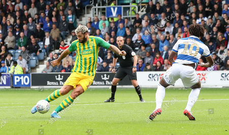 Charlie Austin of West Bromwich Albion shoots - Eberechi Eze of QPR  (R)