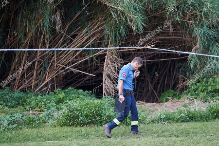 A Catalan police Mossos d'Esquadra officer takes part in the search of the body of a baby who was allegedly thrown into Besos river by a 16-years old boy, the alleged baby's father, in Sant Adria, Barcelona, northeastern Spain, 25 September 2019. Policemen and firefighters try to find the body since the early hours. According to investigation sources, the boy was trying to bury the baby's body when he was surprised by several residents so he decide to throw the baby into de river. The teenager was arrested by the police.