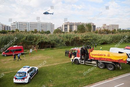 Stock Image of Catalan police Mossos d'Esquadra officers and firefighters take part in the search of the body of a baby who was allegedly thrown into Besos river by a 16-years old boy, the alleged baby's father, in Sant Adria, Barcelona, northeastern Spain, 25 September 2019. Policemen and firefighters try to find the body since the early hours. According to investigation sources, the boy was trying to bury the baby's body when he was surprised by several residents so he decide to throw the baby into de river. The teenager was arrested by the police.