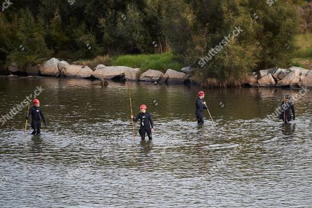 Stock Photo of Catalan police Mossos d'Esquadra officers and firefighters take part in the search of the body of a baby who was allegedly thrown into Besos river by a 16-years old boy, the alleged baby's father, in Sant Adria, Barcelona, northeastern Spain, 25 September 2019. Policemen and firefighters try to find the body since the early hours. According to investigation sources, the boy was trying to bury the baby's body when he was surprised by several residents so he decide to throw the baby into de river. The teenager was arrested by the police.