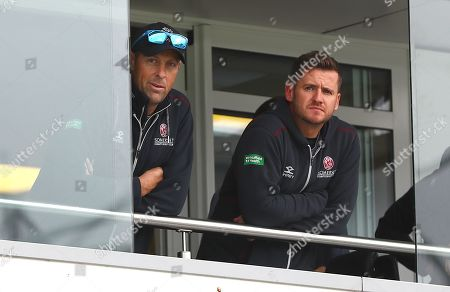 Marcus Trescothick and Steve Davies of Somerset look on from the balcony as play is called off for the day