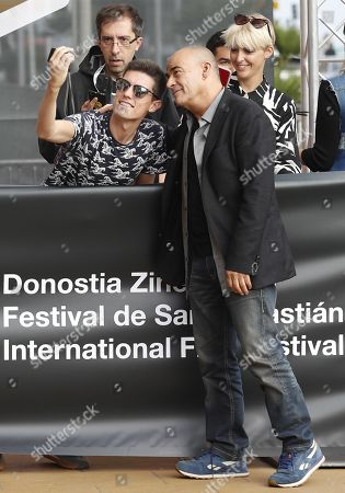 Eduard Fernandez (R) poses for a photo with a fan upon his arrival to present the film 'La hija de un ladron' (A Thief's Daughter) as part of San Sebastian International Film Festival, in San Sebastian, Basque Country, Spain, 25 September 2019. The film competes in the official section of the festival running from 20 to 28 September.