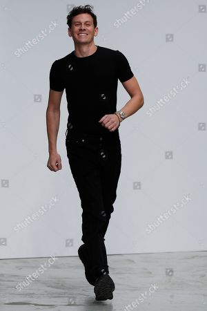 Designer Casey Cadwallader acknowledges applause after the Mugler Ready To Wear Spring-Summer 2020 collection, unveiled during the fashion week, in Paris