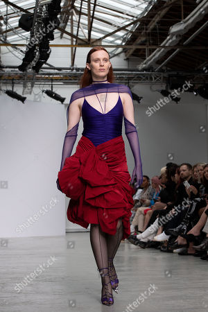 British model Karen Elson presents creations from the Spring/Summer 2020  Ready to Wear collection by US designer Casey Cadwallader for Mugler during the Paris Fashion Week, in Paris, France, 25 September 2019. The presentation of the Spring/Summer 2020 collections runs from 23 September to 1 October 2019.