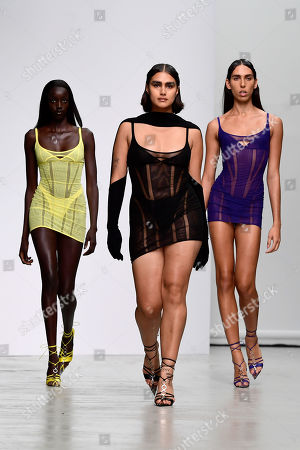 Stock Image of Transgender model Raya Martigny (R) along with other models present creations from the Spring/Summer 2020  Ready to Wear collection by American designer Casey Cadwallader for Mugler label brand during the Paris Fashion Week, in Paris, France, 25 September 2019. The presentation of the Spring/Summer 2020 collections runs from 23 September to 1 October 2019.