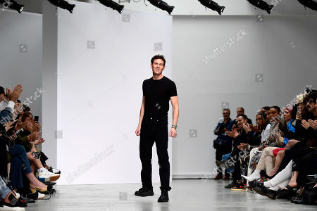 Stock Photo of US designer Casey Cadwallader appears on the catwalk after his show for Mugler during the Paris Fashion Week, in Paris, France, 25 September 2019. The presentation of the Spring/Summer 2020 collections runs from 23 September to 1 October 2019.