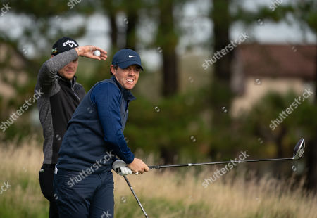 Rory McIlroy on the 12th tee at Carnoustie, watched by Danny Willett.