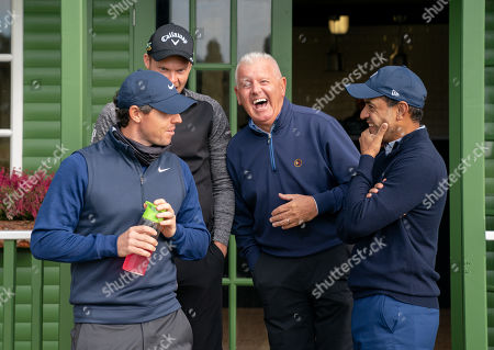 Rory McIlroy, Danny Willets, Gerry McIlroy & Mohammed Faros share a joke at the hut on the 10th hole before starting their round.