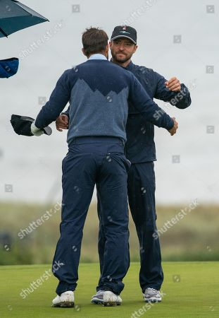 Justin Timberlake embraces Jamie Redknapp on the 18th green at Kingsbarns Golf Links, during the 2nd Round of The Alfred Dunhill Links Championship.