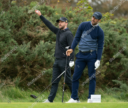 Justin Timberlake signals right after Jamie Redknapp hit a wayward drive on the 11th tee at Kingsbarns Golf Links, during the 2nd Round of The Alfred Dunhill Links Championship.