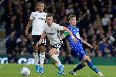 Joe Bryan of Fulham and Lee Evans of Wigan Athletic in action during the Sky Bet Championship match between Fulham and Wigan Athletic at Craven Cottage in London, UK - 27th September 2019