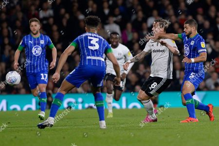 Stefan Johansen of Fulham and Sam Morsy of Wigan Athletic in action during the Sky Bet Championship match between Fulham and Wigan Athletic at Craven Cottage in London, UK - 27th September 2019