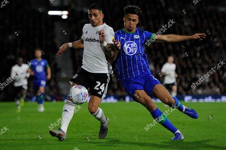 Anthony Knockaert of Fulham and Antonee Robinson of Wigan Athletic in action during the Sky Bet Championship match between Fulham and Wigan Athletic at Craven Cottage in London, UK - 27th September 2019