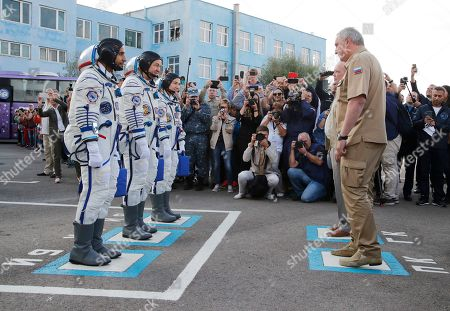 From left: United Arab Emirates astronaut Hazza Almansoori, Russian cosmonaut Oleg Skripochka, and U.S. astronaut Jessica Meir, members of the main crew of the expedition to the International Space Station (ISS), report to head or Russian space agency Dmitry Rogozin prior the launch of Soyuz MS-15 space ship at the Russian leased Baikonur cosmodrome, Kazakhstan