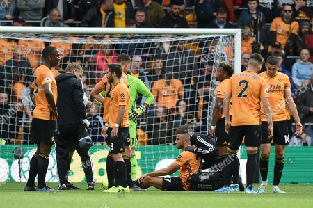 Stock Photo of 28th September 2019, Molineux, Wolverhampton, England; Premier League, Wolverhampton Wanderers v Watford : Romain Saiss (27) of Wolverhampton Wanderers receives treatment during the game
