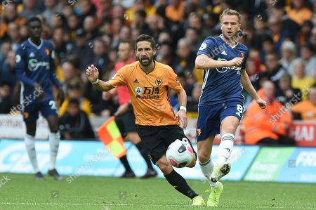 28th September 2019, Molineux, Wolverhampton, England; Premier League, Wolverhampton Wanderers v Watford : Tom Cleverley (8) of Watford ahead of Joao Moutinho (28) of Wolverhampton Wanderers  