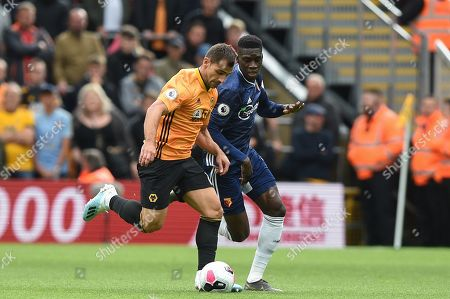 28th September 2019, Molineux, Wolverhampton, England; Premier League, Wolverhampton Wanderers v Watford : Jonny Otto (19) of Wolverhampton Wanderers and Ismaila Sarr (23) of Watford contest the ball