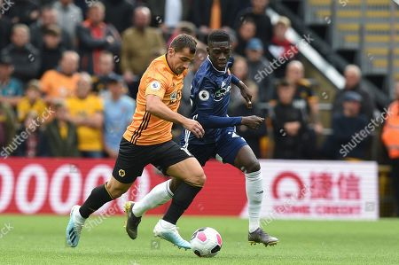 Stock Photo of 28th September 2019, Molineux, Wolverhampton, England; Premier League, Wolverhampton Wanderers v Watford : Jonny Otto (19) of Wolverhampton Wanderers and Ismaila Sarr (23) of Watford contest the ball