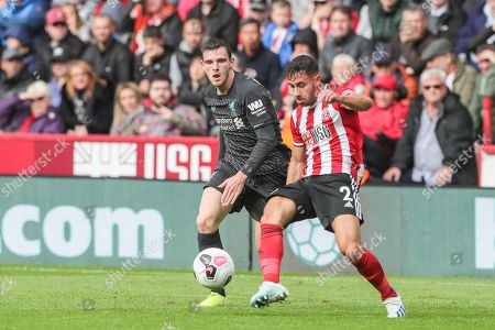 28th September 2019, Bramall Lane, Sheffield, England; Premier League, Sheffield United v Liverpool : George Baldock (2) of Sheffield United clears the ball from Andrew Robertson (26) of Liverpool  Credit: Mark Cosgrove/News Images