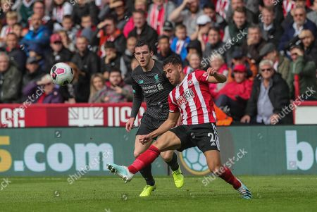 28th September 2019, Bramall Lane, Sheffield, England; Premier League, Sheffield United v Liverpool : George Baldock (2) of Sheffield United clears the ball as Andrew Robertson (26) of Liverpool pressures  Credit: Mark Cosgrove/News Images