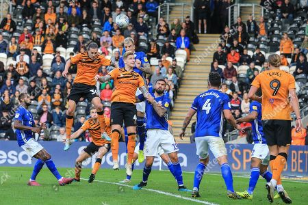 28th September 2019, KCOM Stadium, Hull , England; Sky Bet Championship Football, Hull City vs Cardiff City; Jackson Irvine (36) 0f Hull City and Jordy De Wijs (4) of Hull City challenge for the ball Credit:   David Greaves/News Images English Football League images are subject to DataCo Licence