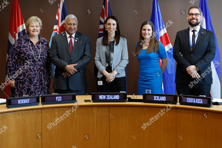 Stock Image of Duayner Salas, Frank Bainimarama, Erna Solberg, Katrin Jakobsdottir. The Prime Minister of Norway Erna Solberg, left, the Prime Minister of Fiji Frank Bainimarama, second from left, the Prime Minister of New Zealand, Jacinda Ardern, center, the Prime Minister of Iceland Katrin Jakobsdottir, second from right, and the Costa Rican Vice Minister of Foreign Trade Duayner Salas Chaverri, pose for a picture after an press event at U.N. headquarters . The countries were announcing a new initiative on climate change and trade