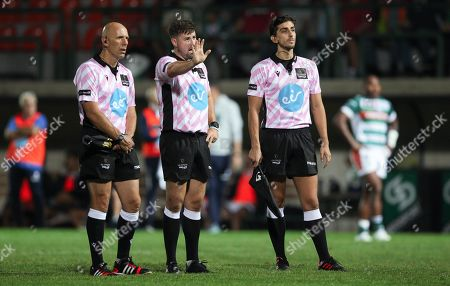 Referee Ben Whitehouse flanked by assistants Gianluca Gnecchi and Gwyn Morris consults with the TMO