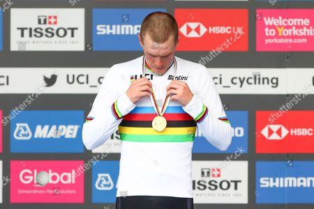 Australia's Rohan Dennis on the podium in the rainbow jersey after winning the Men's Elite Individual Time Trial.