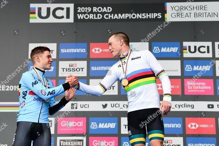 Remco Evenepoel of Belgium and Australia's Rohan Dennis on the podium after the Men's Elite Individual Time Trial.