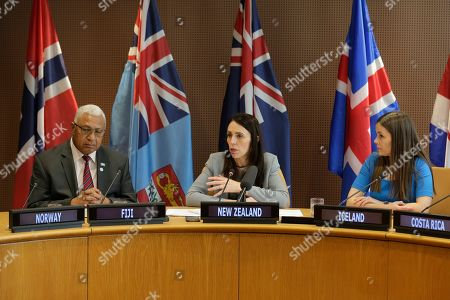 While the Prime Minister of New Zealand Jacinda Ardern, center, speaks the Prime Minister of Fiji Frank Bainimarama, left, and the Prime Minister of Iceland Katrin Jakobsdottir listen during a press event at U.N. headquarters . The countries were announcing a new initiative on climate change and trade