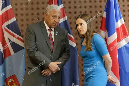 The Prime Minister of Fiji Frank Bainimarama left, talks with the Prime Minister of Iceland Katrin Jakobsdottir before a press event at U.N. headquarters . The countries were announcing a new initiative on climate change and trade