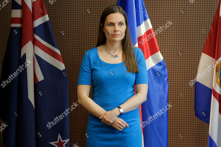 The Prime Minister of Iceland Katrin Jakobsdottir waits for the start of a press event at U.N. headquarters . The countries were announcing a new initiative on climate change and trade