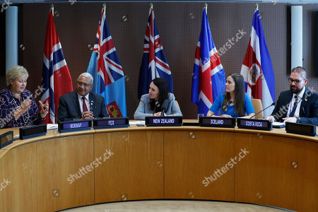 The Prime Minister of Norway Erna Solberg, left, the Prime Minister of Fiji Frank Bainimarama, second from left, the Prime Minister of New Zealand, center, the Prime Minister of Iceland Katrin Jakobsdottir, second from right, and the Costa Rican Vice Minister of Foreign Trade Duayner Salas participate in a press event at U.N. headquarters . The countries were announcing a new initiative on climate change and trade