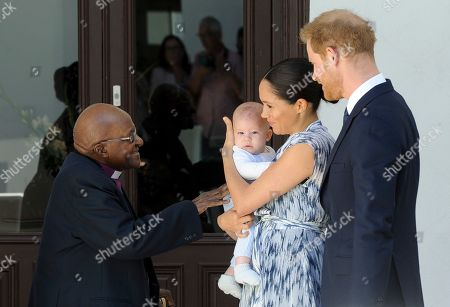 Britain's Prince Harry, The Duke of Sussex (R) and his wife Meghan, Duchess of Sussex (C) holding her son Archie, meet Archbishop Desmond Tutu (L) and his daughter Thandeka (not pictured) at the Desmond & Leah Tutu Legacy Foundation in Cape Town, South Africa 25 September 2019. The Duke and Duchess of Sussex are on an official visit to South Africa. Founded in Cape Town in 2013, the Desmond & Leah Tutu Legacy Foundation contributes to the development of youth and leadership, facilitates discussions about social justice and common human purposes and makes the lessons of Archbishop Tutu accessible to new generations. It is located in one of Cape Town's oldest buildings and a national landmark, The Old Granary Building.