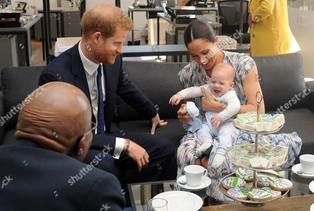 Britain's Prince Harry, The Duke of Sussex (2-L) and his wife Meghan, Duchess of Sussex (R) holding her son Archie, have tea with Archbishop Desmond Tutu (L) and his daughter Thandeka (not pictured) at the Desmond & Leah Tutu Legacy Foundation in Cape Town, South Africa 25 September 2019. The Duke and Duchess of Sussex are on an official visit to South Africa. Founded in Cape Town in 2013, the Desmond & Leah Tutu Legacy Foundation contributes to the development of youth and leadership, facilitates discussions about social justice and common human purposes and makes the lessons of Archbishop Tutu accessible to new generations. It is located in one of Cape Town's oldest buildings and a national landmark, The Old Granary Building.