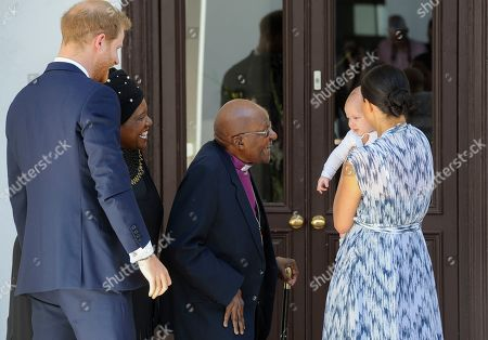 Britain's Prince Harry, The Duke of Sussex (L) and his wife Meghan, Duchess of Sussex (R) holding her son Archie, meet Archbishop Desmond Tutu (C) and his daughter Thandeka (2-L) at the Desmond & Leah Tutu Legacy Foundation in Cape Town, South Africa 25 September 2019. The Duke and Duchess of Sussex are on an official visit to South Africa. Founded in Cape Town in 2013, the Desmond & Leah Tutu Legacy Foundation contributes to the development of youth and leadership, facilitates discussions about social justice and common human purposes and makes the lessons of Archbishop Tutu accessible to new generations. It is located in one of Cape Town's oldest buildings and a national landmark, The Old Granary Building.