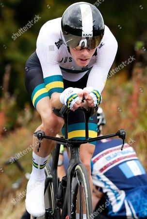 Australia's Rohan Dennis competes on his way to win the men's elite individual time trial event, at the road cycling World Championships in Harrogate, England
