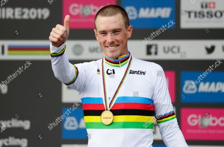 Australia's Rohan Dennis celebrates on the podium after winning the men's elite individual time trial event, at the road cycling World Championships in Harrogate, England
